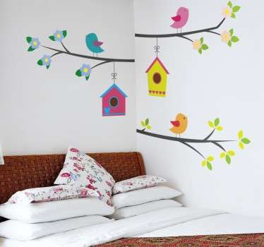 Bright and cheerful bird wall sticker of three colourful birds sitting on a flowering branch with some vibrant bird houses hanging below. Perfect tree wall decal to decorate the corners of your bedroom, living room or child's room.