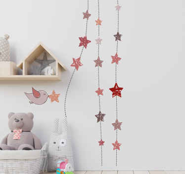Children's room wall sticker showing an illustration of a bird with a star in its beak and some hanging stars in pastel colours. A delicate sticker that is perfect to add a special touch to a little girl's bedroom.