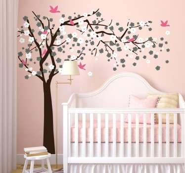 A beautiful and delicate tree wall sticker of a flowering blossom tree, accompanied by the silhouettes of some pink birds, perfect for decorating a nursery, child's bedroom or living room.