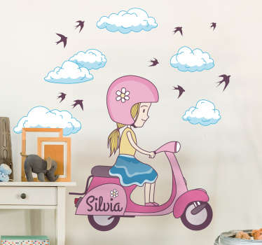 A children's wall sticker of a little girl riding on a white scooter surrounded by clouds and birds. Customise this decal by adding your child's name to make it more personal for them.