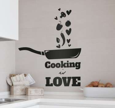 "A kitchen wall sticker for everyone who feels passionate about cooking. Monochrome design of a frying pan tossing some food and hearts, complete with the phrase ""cooking is love"" written underneath."