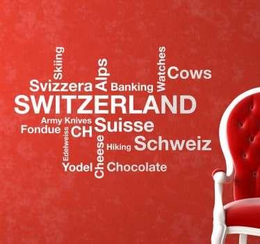 Sticker mural représentant différents mots en anglais qui sont souvent associés à la Suisse : le chocolat, les Alpes, le ski.