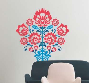 A beautifully ornate wall sticker with a symmetrical floral design in three different colours.