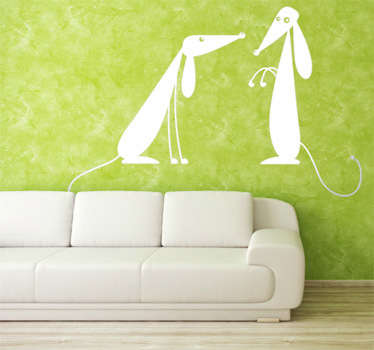 Vinilo decorativo de pared representado por dos simpáticos perritos. Adhesivo decorativo ideal para los amantes de estos animales.