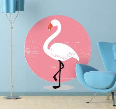 A cool design of a flamingo standing on one leg with a beautiful pink sunset in the background.