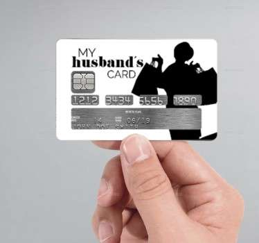 "The credit card sticker consists of a silhouette woman holding shopping bags, next to some text which says ""My husbands card!"""