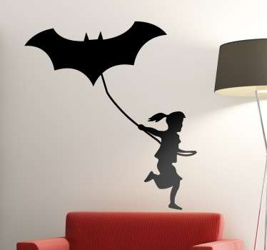 Decorative superhero girl wall sticker to decorate any space.  It is a girl running with kite bat  in silhouette style. It is self adhesive.