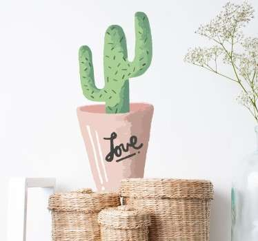 "A wall sticker showing Cactus in a pot but written on the pot is the words ""love"" in a signature font."