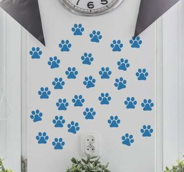 Vinil decorativo de uma ilustração de pegadas do melhor amigo do homem, o cão. Adesivo de parede para decoração de interiores.