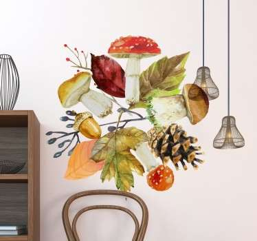 The Wall sticker consists of different autumn elements such as leaves, mushrooms, an acorn and a pine cone.
