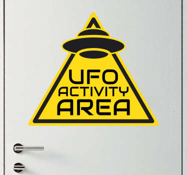 "This sticker consists of a warning sign with the phrase ""UFO activity area""."