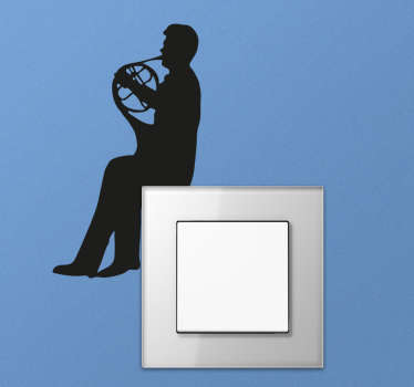 The switch sticker consists of a silhouette man playing the french horn.