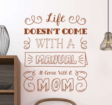 """The wall sticker consists of the phrase """"Life doesn´t come with a manual it comes with a mom"""" all written in different fonts"""
