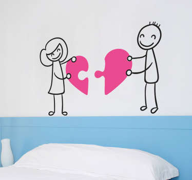 The wall sticker consists of a man and woman holding opposite pieces of a heart puzzle piece.