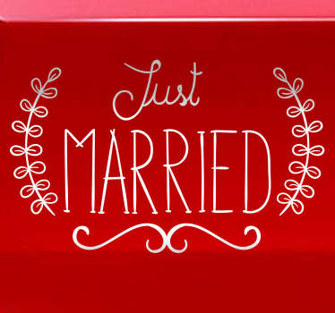 "This wall sticker consists of the phrase ""Just Married"" written in an eloquent font"