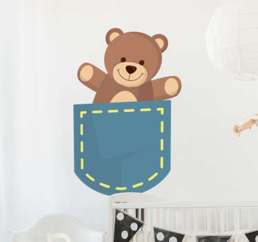 The kid's wall sticker consists of a cute teddy bear sitting in a pocket.