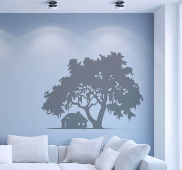 The wall sticker consists of a house under a large tree, away from the noise of the city.