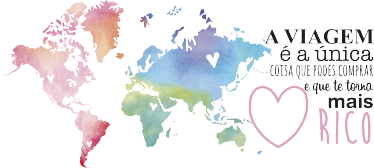 """TenStickers. Mural de parede mapa colorido com texto. Mural de parede com mapa colorido e com texto pensado para qualquer turista: """"A viajem é a única coisa que podes comprar e que te torna mais rico""""."""
