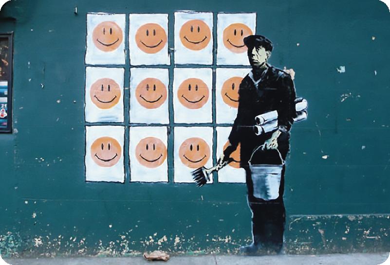 TenVinilo. Vinilo para portátiles Banksy sonríe. Pegatina para portátil formada por una obra del artista Bansky, el cual critica la publicidad con unos carteles con sonrisas. Envío Express en 24/48h.