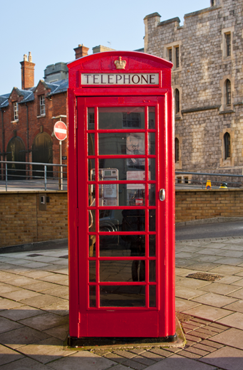 TenStickers. British Telephone Box Wall Mural. Photo Murals - Add a British touch to your room with this shot of a red British phone box.