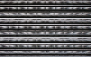 TenStickers. Shutter Texture Laptop Sticker. Customize your laptop with this photograph of a closed metal shutter. A sticker that will turn your device into a unique item.
