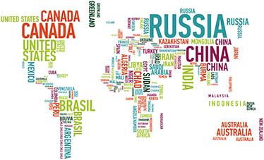 TenStickers. Naklejka na ścianę kolorowa mapa świata. Dekoracyjna naklejka na ścianę przedstawiająca kolorową mapę świata, która jest zbudowana z nazw państw.
