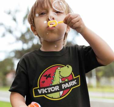 Dinosaur kids t-shirt ofJurassic Park. he design is made up of a funny dinosaur with a mischievous face. Make the little ones enjoy their new outfit.