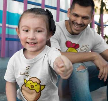 Friendly funny matching father and kids t-shirt design of a chicken and a chick in a T-shirt so that parents and children can wear the same clothes.
