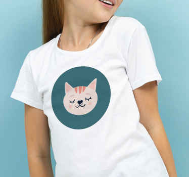 Kid's t-shirt which features a cute image of a cat smiling inside of a circle. Available in various sizes. High quality.