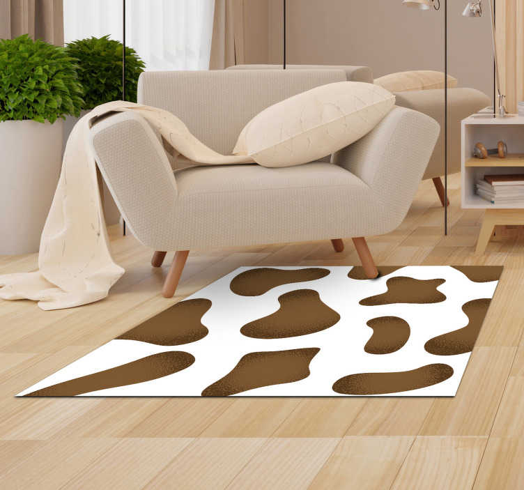 TenStickers. Tapis en vinyle marron imprimé animal de vache. Incroyable tapis sticker imprimé animal en cuir de vachette marron avec lequel vous ravirez votre intérieur avec une stickersoriginale et exclusive!