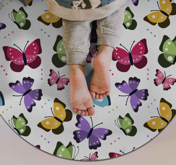 TenVinilo. Alfombra de vinilo mariposas redonda. Maravillosa alfombra vinílica animal con forma redonda y mariposas volando de diferentes colores para que decorar habitación de niña. Gran calidad.