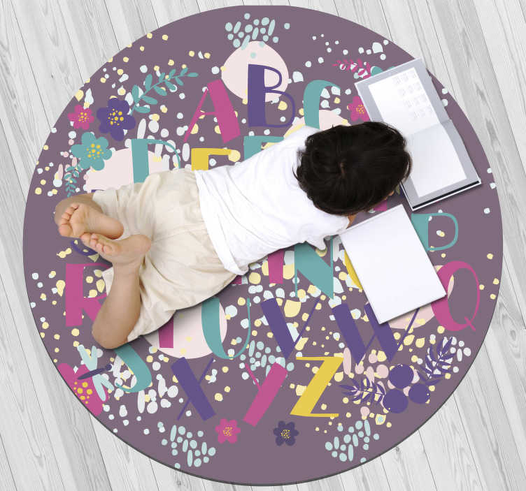 TenStickers. Floral alphabet vinyl rug. Nice vinyl alphabet carpet for children with a round shape that will leave a unique decoration in your daughter's room!!