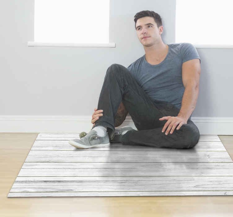 TenStickers. Tappeto in vinile stile legno bianco. Ottimo tappeto in vinile effetto legno che migliorerà il tuo arredamento non appena entrerà a far parte della tua casa! Acquista ora per un ottimo prodotto!