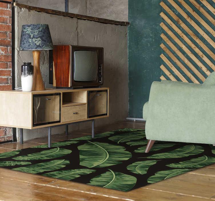 TenStickers. Vinylový koberec z tropických listů. Tento elegantní koberec z tropických listů je nejlepším řešením, pokud chcete výrazně zlepšit dopad každé místnosti vašeho domu!