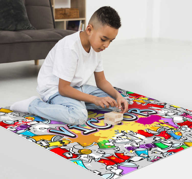 TenStickers. Multicolour graffiti personalised vinyl rug. Make your child's name stand out with this beautiful graffiti vinyl carpet design with a gravity name background! Extremely long-lasting material.