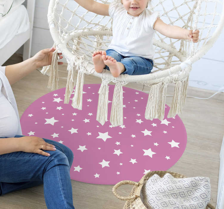 TenStickers. Pink Stars round vinyl carpet. This magnificent round vinyl rug of white stars on a pink background will look beautiful in your children's room. Choose your size!