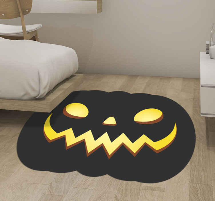 TenStickers. Terrifying halloween pumpkins living room rug.  Terrifying decorative Halloween pumpkins vinyl rug. The design is a black pumpkin with yellow face detail. Made from high quality vinyl.