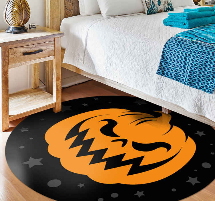 TenStickers. Orange pumpkins on black background living room rug. Orange pumpkins Halloween featured vinyl carpet. The design is design is suitable for a living room and it can be applied on any other space.