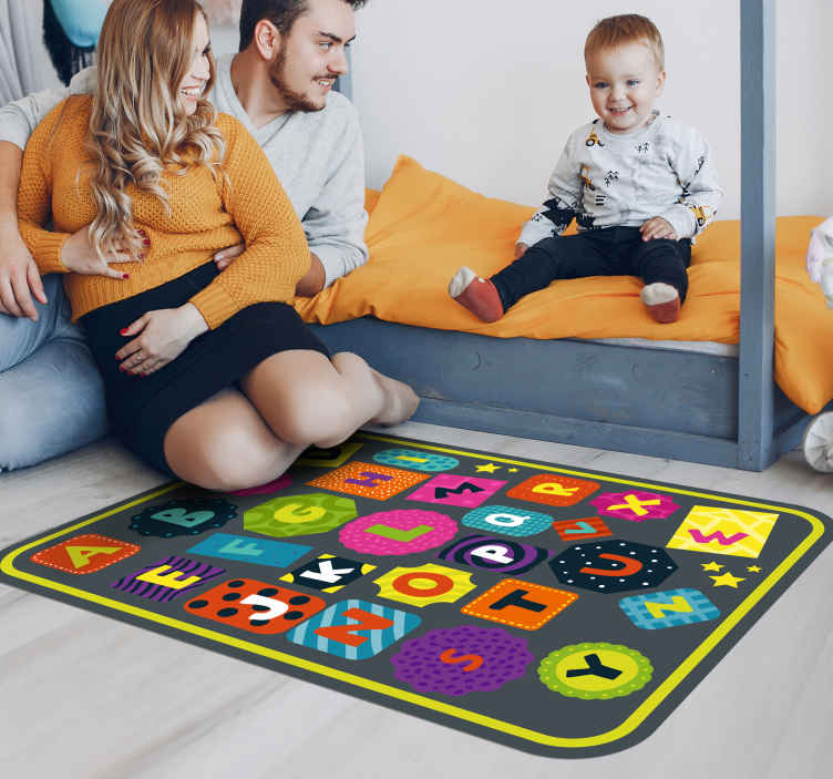 TenStickers. Childrens colorful alphabet alphabet rug. This colorful alphabet letters vinyl rug gives kids a hand in learning the letters of the alphabet and makes it more fun.