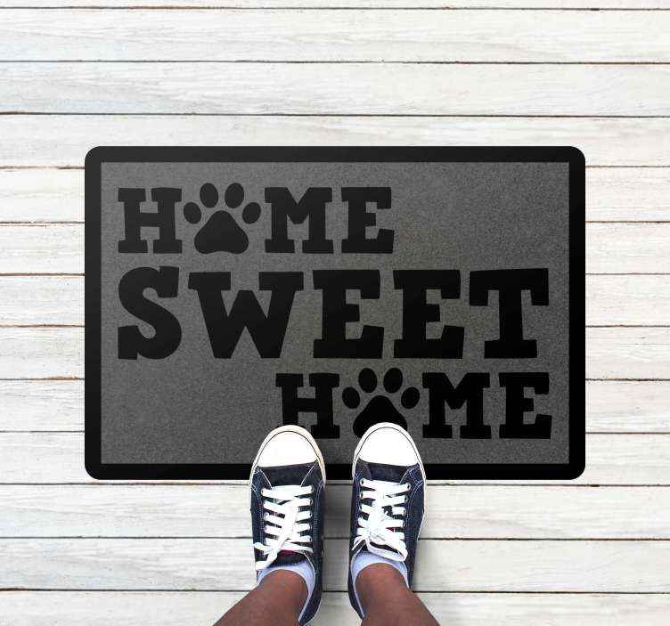 TenStickers. Home sweet home with paws bespoke rugs. This rug features the text 'home sweet home' with the 'O' in home changed to a paw print. Available in a range of sizes.