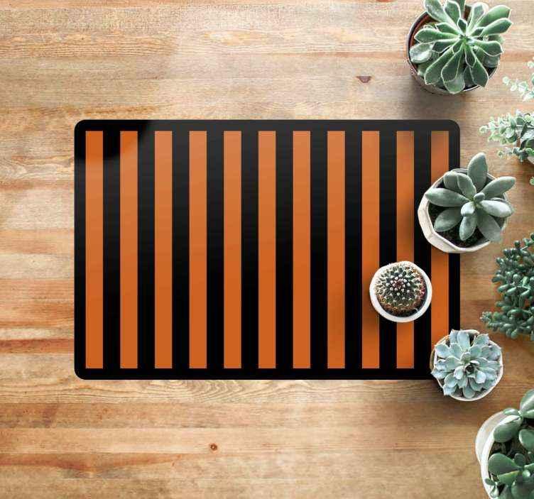 TenVinilo. Alfombras vinilo rayas naranjas y negras. Esta alfombra vinílica salón presenta rayas naranjas y negras rodeadas por un borde negro ¡Regístrese para obtener un 10% de descuento!