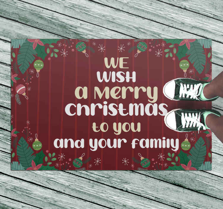 TenStickers. We Wish You a Merry Christmas rug. Christmas vinyl rug which features the text 'we wish you a Merry Christmas to you and your family' surrounded by various Christmas items.