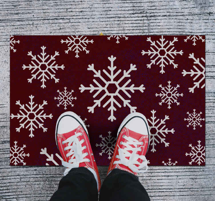 TenStickers. Red and White Snowflakes Christmas vinyl rug. Christmas vinyl rug which features various symmetrical white snowflakes on a lovely dark red background. Made from the best quality vinyl materials.
