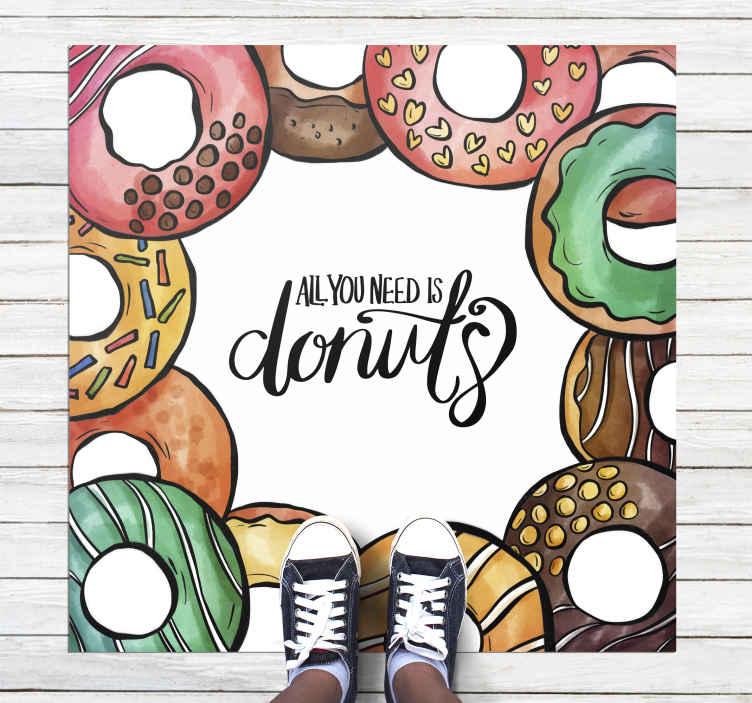 TenStickers. Vinyl vloerbekleding kinderen Alles wat u nodig hebt is vinyl tap. Een kleurrijk alles wat u nodig hebt is donut tekst met donuts vinyl tapijt op een witte achtergrond om iedereen u winkel binnen te laten komen of om uw huis te versieren.