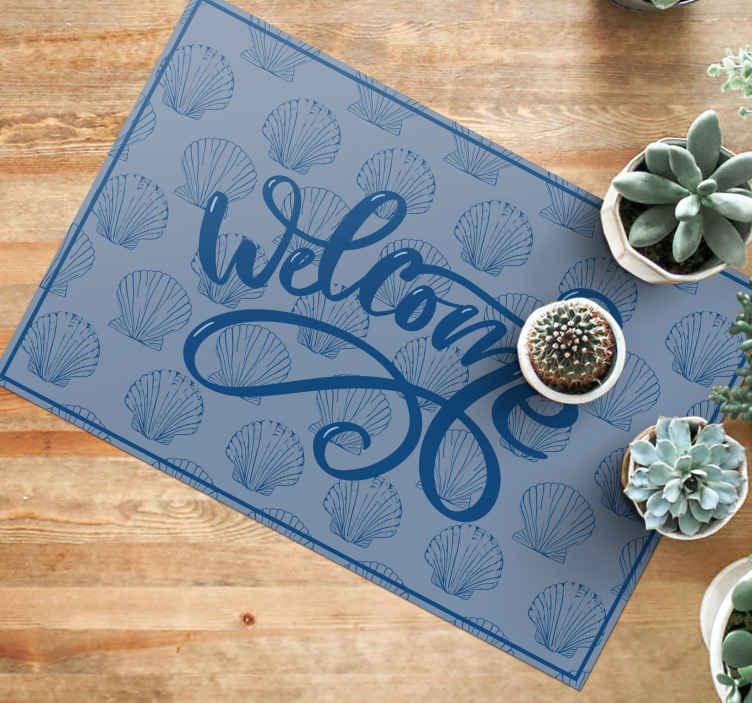 TenStickers. Seashell Blue Tones bespoke rugs. our amazing seashell blue tones vinyl rug has a welcome text on it with various seashells printed on it. It is easy to maintain, it can be cleaned.