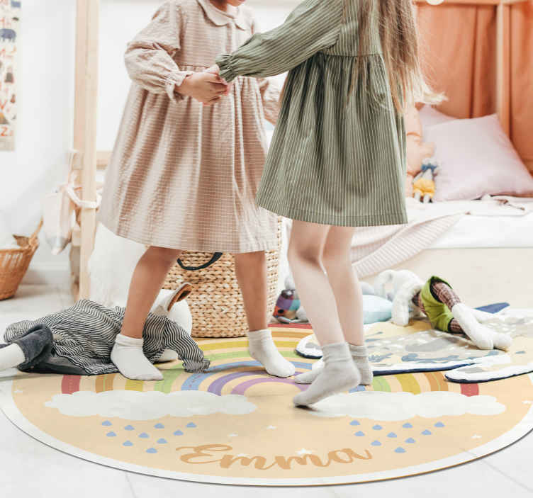 TenStickers. Personalised Rainbow vinyl rug. This kid's vinyl rug features a beautiful rainbow with clouds underneath it with some rain drops coming out. Extremely long-lasting material.