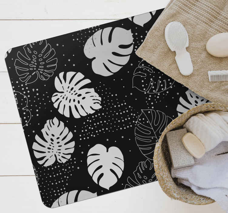 TenStickers. Black and white monstera leaves nature carpet. Black and white monstered leaves vinyl rug design.  It is anti-slippery, anti-allergic and super easy to maintain like a regular floor surface.