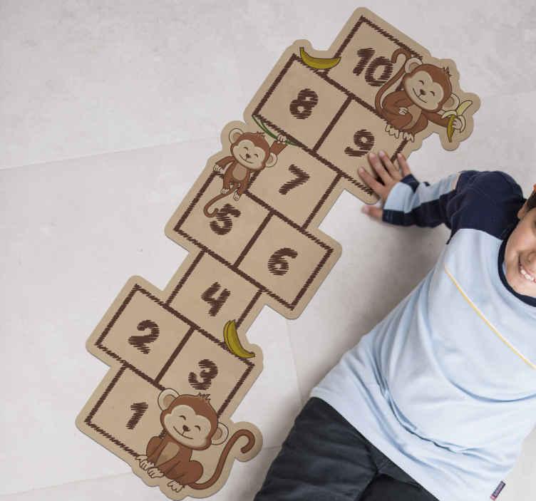 TenStickers. Tappeto in vinile per bambini Campana con scimmie. Tappeto in vinile per bambini con stampe di numeri di gioco raffiguranti una campana. Questo tappeto in vinile per bambini a campana sarebbe uno spazio interessante per il tuo bambino.