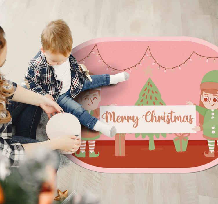 """TenStickers. Tapis de noël elfes de noël. Ce plancher de hall d'entrée est présenté avec deux elfes de noël avec un texte qui dit """"joyeux noël"""". Il est fait de sticker de haute qualité."""
