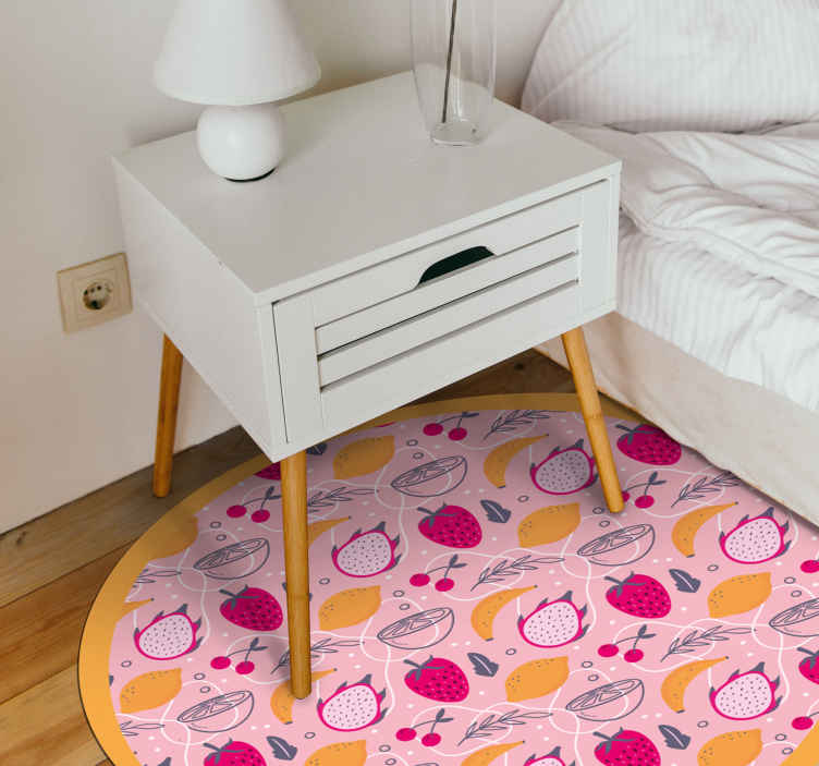 TenStickers. Summer fruits kitchen flooring. Beautiful vinyl carpet for kitchen floor. Pretty pink and yellow colour carpet with a round shape. On the carpet are designs of various summer fruits.